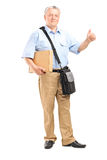 Mature courier holding a package Royalty Free Stock Photography