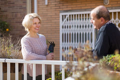 Mature cuople talking at balcon Royalty Free Stock Image
