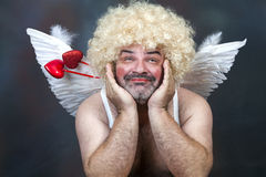 Mature Cupid. Fat bearded mature hairy cupid with bow and heart arrow royalty free stock image