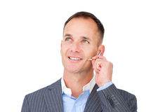 Mature Customer service agent talking on headset Royalty Free Stock Images