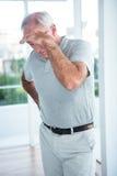 Mature depressed man standing Stock Photography