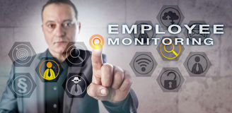 Mature Detective Engaged In EMPLOYEE MONITORING. Mature corporate detective is engaging in EMPLOYEE MONITORING activity. Business concept for workplace royalty free stock image