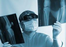 Mature doctor examining X-ray image Royalty Free Stock Photo