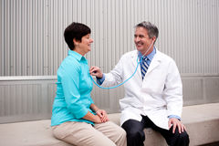 Mature doctor with female patient royalty free stock images