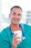 Mature doctor having a break Stock Image