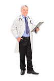 Mature doctor holding a clipboard Stock Photo
