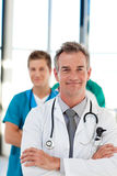 Mature doctor leading his team with copy-space Stock Photos