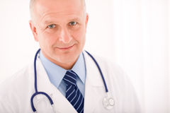 Mature doctor male with stethoscope cross arms Royalty Free Stock Photos