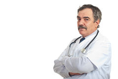 Mature doctor man with  copy space. Mature doctor man standing with arms folded  isolated on white background,copy space for text message isolated on white Stock Image