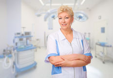 Mature doctor at medical office Stock Photo