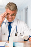 Mature doctor with medicines Royalty Free Stock Images