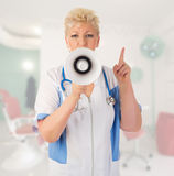 Mature doctor with megaphone Royalty Free Stock Photography