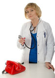 Mature doctor and phone Royalty Free Stock Image