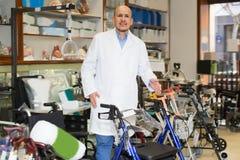 Mature doctor posing near orthopaedic equipment Royalty Free Stock Image