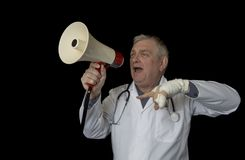 Mature doctor protesting and shouting through a megaphone stock images