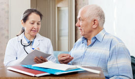 Mature doctor and senior patient Stock Images