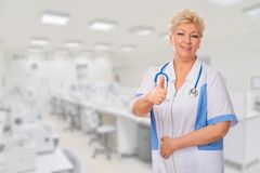 Mature doctor shows ok gesture Royalty Free Stock Photo