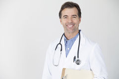 Mature Doctor Smiling At The Camera Stock Images