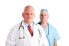 Mature Doctor and Surgical Intern Stock Image