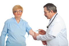 Mature  doctor vaccine patient woman Stock Photo