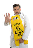 Mature Doctor with warning sign Stock Images