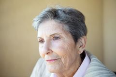 Mature woman feeling lonely and depressed. Mature elderly woman feeling lonely and depressed Stock Image