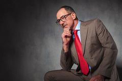 Mature elegant businessman wearing glasses and looking away Royalty Free Stock Image