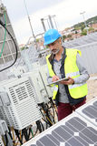 Mature engineer checking solar panels Royalty Free Stock Images