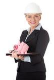 Mature engineer woman with piggybank. Royalty Free Stock Photos