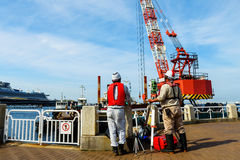 mature engineers with theodolite at construction site Stock Photography