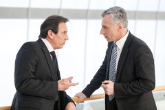 Mature executive discussing with associate. Portrait of mature business men sharing his experience with associate royalty free stock photos