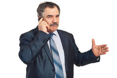Mature executive give explanations at phone Royalty Free Stock Image