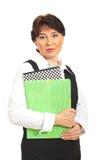 Mature executive holding folders Stock Image