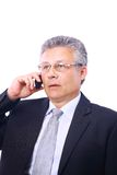 Mature executive man giving. Explanations and talking at phone mobile Royalty Free Stock Photo