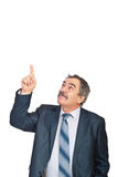 Mature executive pointing upwards to copy Royalty Free Stock Image