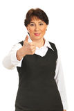 Mature executive woman giving thumbs Stock Photos