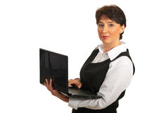 Mature executive woman using laptop Royalty Free Stock Images
