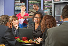 Mature Executives and Working Lunch Stock Images