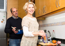Mature family couple cooking Stock Photo