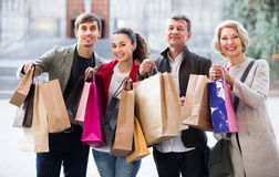 Mature family of four with shopping bags Royalty Free Stock Photo