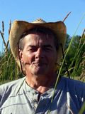 Mature farm worker in fields stock photography