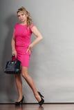Mature fashion woman holds handbag Stock Image