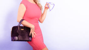 Mature fashion woman holds handbag Stock Photography