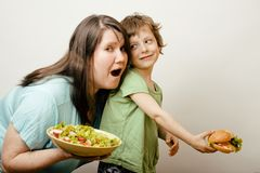 Mature fat woman holding salad and little cute boy Stock Photography