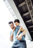 Mature father with his son under the bridge having fun together Stock Photography
