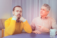 Mature father and son serious talk Stock Image