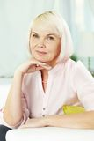 Mature female. Portrait of blond female looking at camera Royalty Free Stock Photos