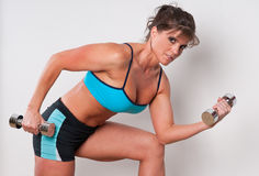 Mature female athlete exercising Royalty Free Stock Photography