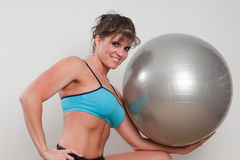 Mature female athlete exercising Stock Photography