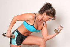 Mature female athlete exercising Stock Image
